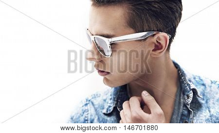 Young handsome man wearing stylish sunglasses,isolated on white background