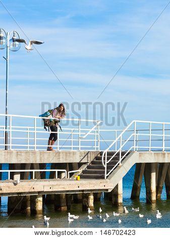 Man Hiker With Backpack On Pier, Sea Landscape