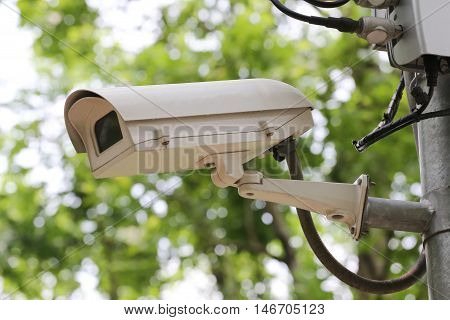 CCTV camera digital video recorder in public park for Security of place.