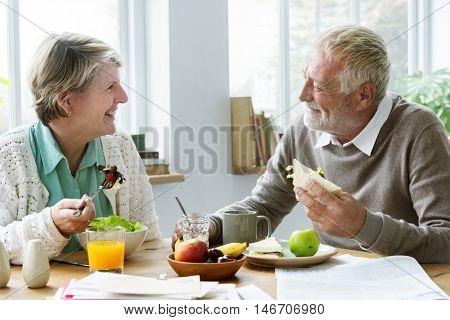 Pensioner Elderly Couple Eating Brunch Concept poster