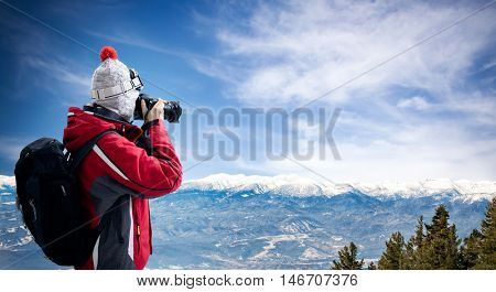 Female photographer take picture of winter landscape, winter holiday