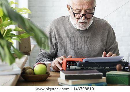 Senior Adult Typing Typerwriter Concept
