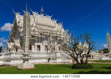 Wat Rong Khun, perhaps better known to foreigners as the White Temple, art exhibit in the style of a Buddhist temple in Chiang Rai Province, Thailand.