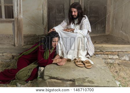 Mary Magdalene crying of shame and embalming Jesus' feet