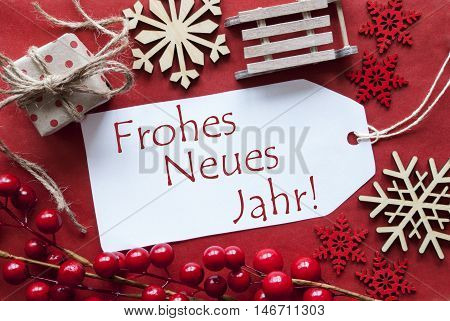 Christmas Decoration Like Gift Or Present, Sleigh. Card For Seasons Greetings With Red Paper Background. German Text Frohes Neues Jahr Means Happy New Year