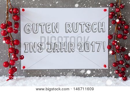 Label With German Text Guten Rutsch Ins Jahr 2017 Means New Year 2017. Red Christmas Decoration On Snow. Urban And Modern Cement Wall As Background With Snowflakes.