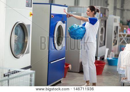 Employees including washing machines in washing machine