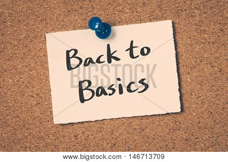 Back to basics note pin on the bulletin board