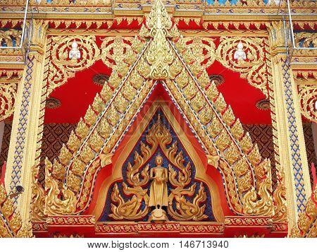 Golden Buddha and angel on gable chapel