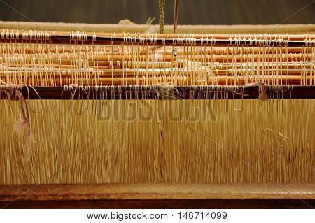 weaving loom for silk heddle is a component in a loom