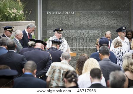 NEW YORK - SEPT 9 2016: Opening prayer at NYC Police Memorial for the NYPD Emerald Society Pipe and Drums 9/11 Memorial Commemoration Service marking the 15th anniversary of the terror attacks.