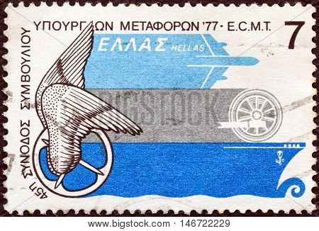 GREECE - CIRCA 1977: A stamp printed in Greece issued for the 45th European Conference of Ministers of Transport shows Emblem and types of transportation, circa 1977.
