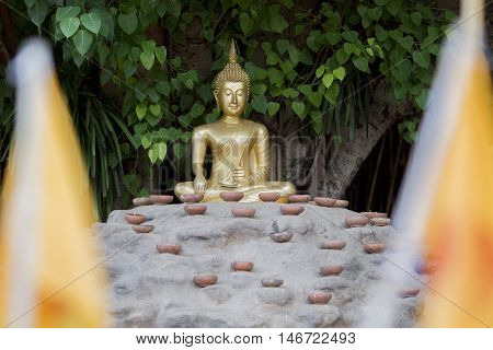 the Buddha with candles and in Phan Tao Temple Chiangmai Thailand