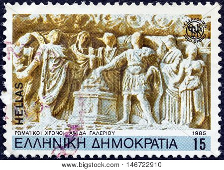 """GREECE - CIRCA 1985: A stamp printed in Greece from the """"2300th anniversary of Thessaloniki city"""" issue shows Roman period Galerius's Arch (detail), circa 1985."""
