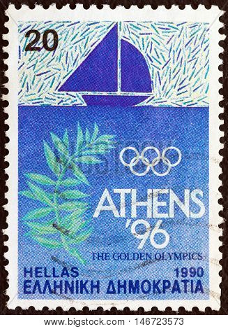 GREECE - CIRCA 1990: A stamp printed in Greece issued for Athens candidacy of 1996 summer Olympic games shows sailing and olive branch, circa 1990.