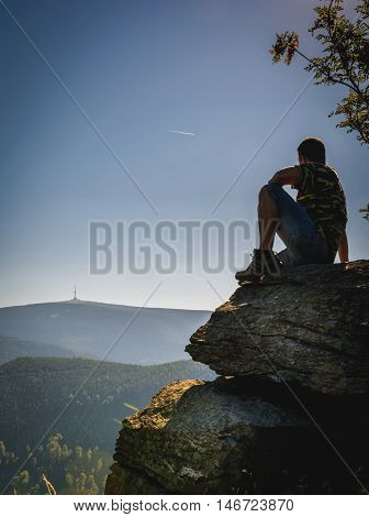 Man looking to the highest mountain Praded of Czech mountains Jeseniky