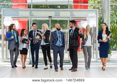 Business People Group Discussion Meeting, Smile Talking In Modern Office, Businesspeople Colleague Team Over Glass Door