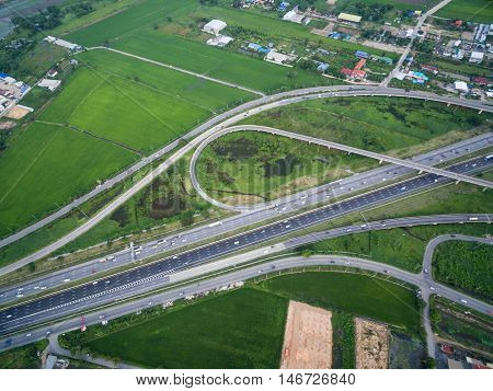 aerial view of traffic junction and transportation road in city top and birdeyes view shot 90 degree blur background