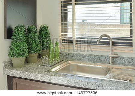 Sink With Grey Color Counter Top In The Kitchen