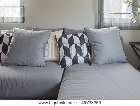 Black And White Parallelogram Pattern Pillows On Gray L Shape Comfy Sofa