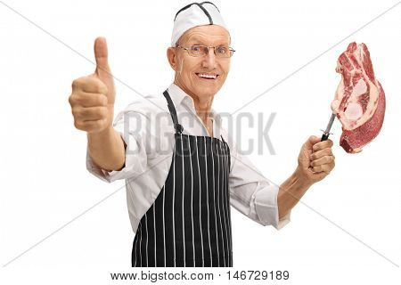 Mature butcher holding an uncooked stea and giving a thumb up isolated on white background