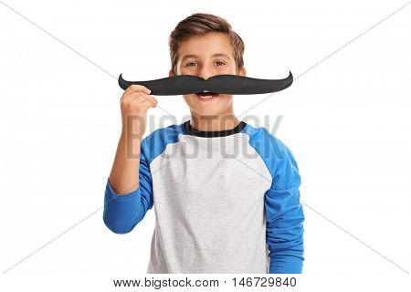 Happy kid posing with a fake moustache isolated on white background