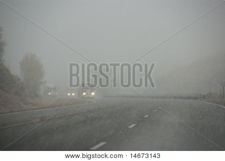 Truck And Other Vehicles Moving Through Fog