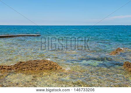 Typical beach and bue sea in Istria, Croatian coast
