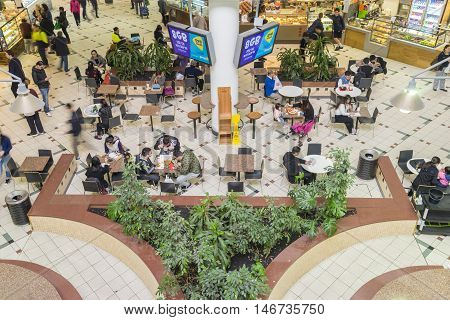 Melbourne, Australia - September 4, 2015: People dining in food court in Box Hill Central Shopping Centre in Melbourne.