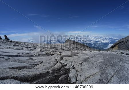 The beauty of Mount Kinabalu Sabah Malaysia with the view of South Peak (3921m). Mount Kinabalu or Gunung Kinabalu is the 20th most prominent mountain in the world by topographic prominence.