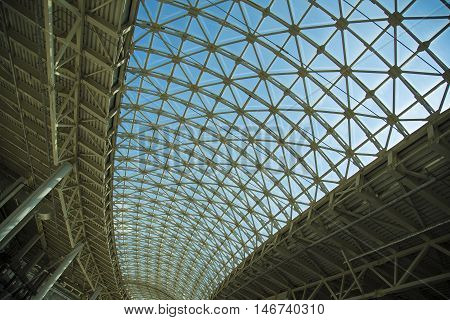 Steel structure roof ceiling made of metal and glass with blue sky background