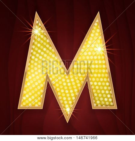 Gold light lamp bulb letter M for burlesque style sparkling design