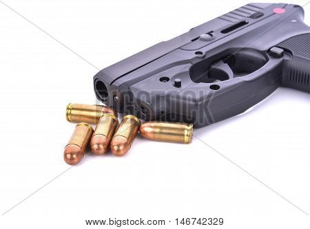 Bullets with the gun on white background .