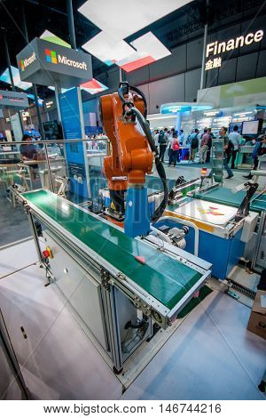 SHANGHAI CHINA - SEPTEMBER 2 2016: Industrial KUKA robot at Huawei Connect 2016 information technology conference and exhibition in Shanghai China on September 2 2016.