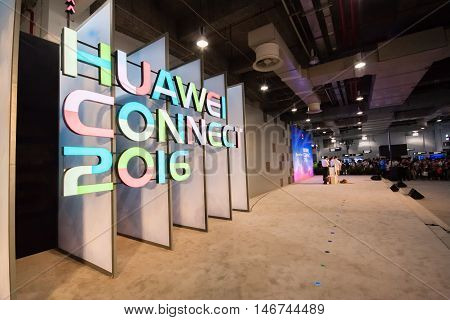 SHANGHAI CHINA - SEPTEMBER 2 2016: Attendees of Huawei Connect 2016 information technology conference at World Expo Exhibition and Convention Center hall in Shanghai China on September 2 2016.