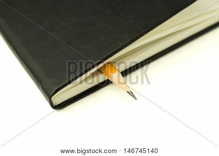 Black Diary and pencil on over  white