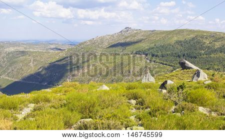 background landscape panorama view of the valley with rocks in the mountain park of Sierra de Eshtrella in Portugal, Europe