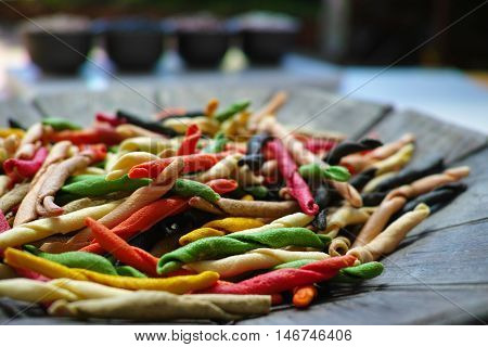 Traditional colorful Italian dried homemade pasta fusilli with eight colors from Salerno.