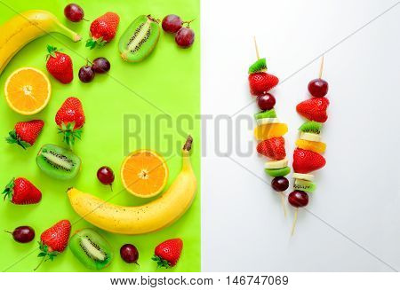 Fruit and berry skewers concept simple healthy raw meal and ingredients top view
