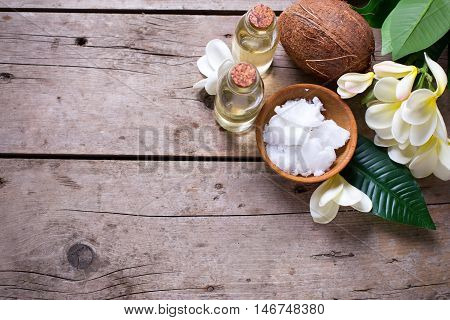 Spa set with coconuts. Coconuts and coconut oil on vintage wooden background. Natural organic spa products. Place for text.
