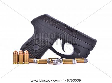 Bullets with the gun on white background