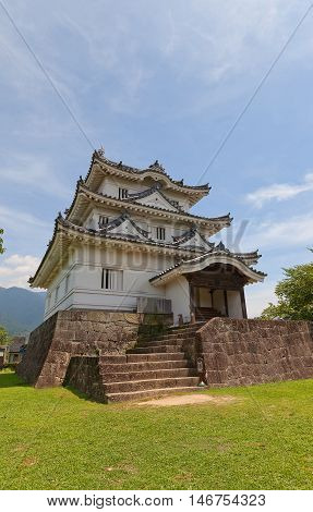 UWAJIMA JAPAN - JULY 22 2016: Main keep (Tenshukaku circa 16th c.) of Uwajima castle Shikoku Island Japan. Uwajima is one of only 12 survived castles in Japan
