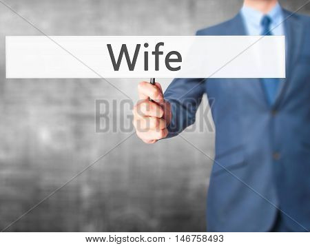 Wife - Businessman Hand Holding Sign
