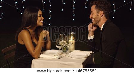 Romantic couple enjoying an evening dinner