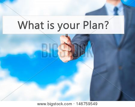 What Is Your Plan ? - Businessman Hand Holding Sign