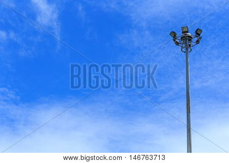 Electric post with blue sky and soft cloud