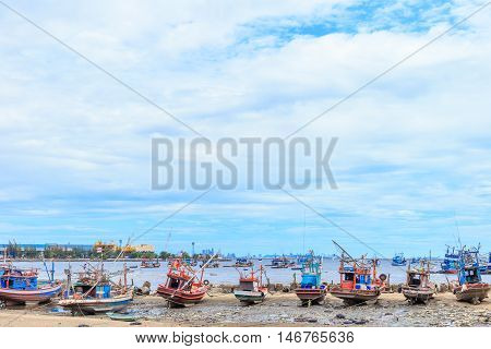fishing boat aground on beach and bluesky