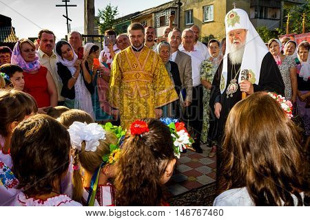 Perechin - Transcarpathia - Ukraine-11 September 2016: Children and parishioners meet the Patriarch of the Ukrainian Orthodox Church Kiev Patriarchate Filaret before the consecration of a new wooden church.