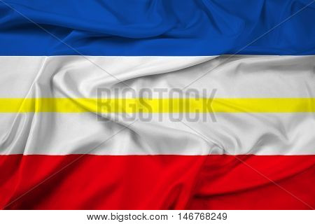 Waving Flag of Mecklenburg-Western Pomerania Germany, with beautiful satin background. 3D illustration