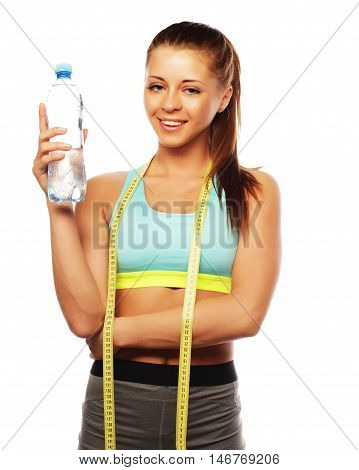 Fitness and gym. Smiling young woman with water. Isolated over white background